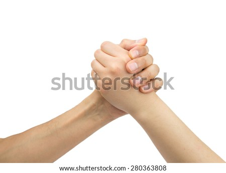 two hands of one man and one woman in arm wrestling with white background as concept fight between sexes - stock photo