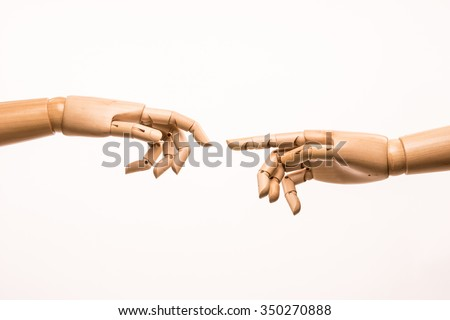 Two hands of wood parody the birth of Adam by Michelangelo - stock photo