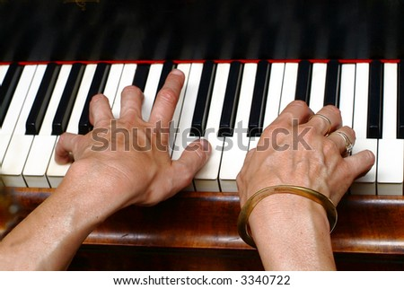 two hands on piano keys