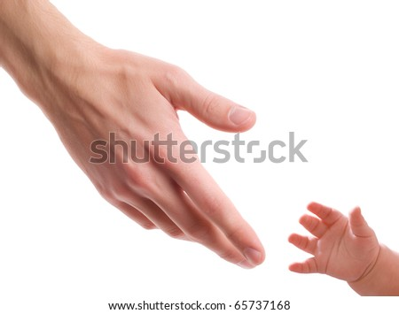 Two hands - one of man and one of child - stock photo