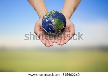 Two hands open gesture holding the earth on blurred map over beautiful colorful sky backgrounds.Elements of this image furnished by NASA.safe and healing world concept.environment day concept. - stock photo
