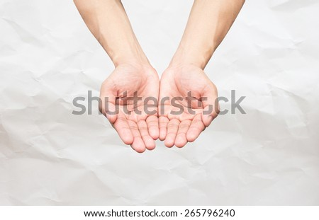 Two hands open palm gesture on white crumpled paper background - stock photo