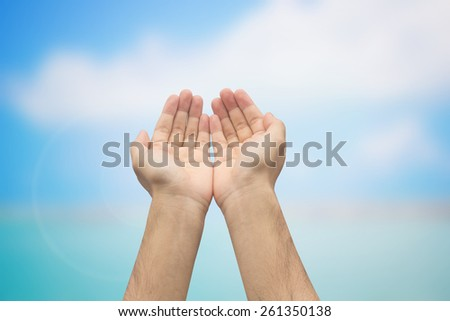 Two hands open palm gesture showing on blurred sea backgrounds,soft focused - stock photo