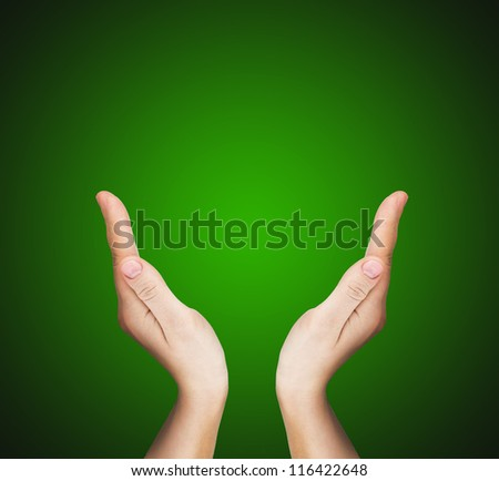 two hands over green background - stock photo