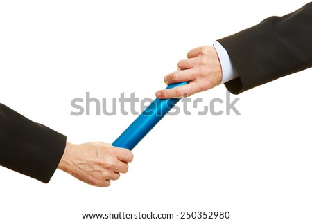 Two hands passing a blue relay baton - stock photo