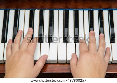Two hands playing piano