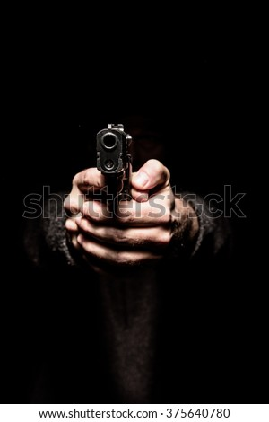 Two hands pointing a gun forward, concept of threat, danger and oppression - stock photo