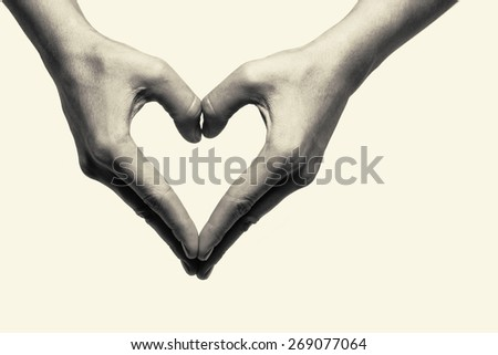 Two hands portraying heart - stock photo