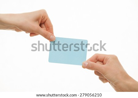 Two hands pull in different directions a blue paper card, white background - stock photo