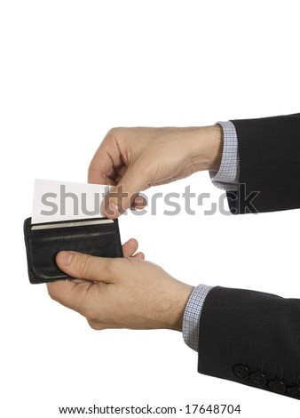 Two hands pull out a white card from a black leather wallet.