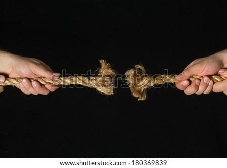 Hands Pulling Apart