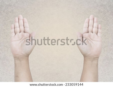 Two hands raised up. - stock photo
