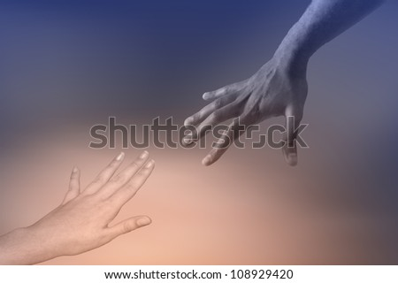 Two hands reaching out to each other in friendship or assistance - stock photo