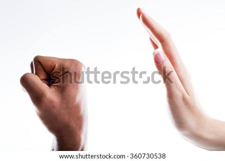 two hands representing violence and menaces and opposing calm and willpower