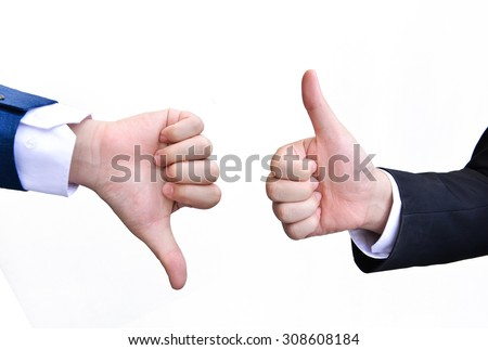 Two hands thumb up and thumbs down - stock photo