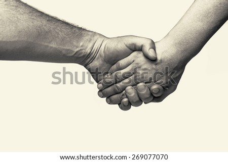 Two hands (union of two friends) - stock photo