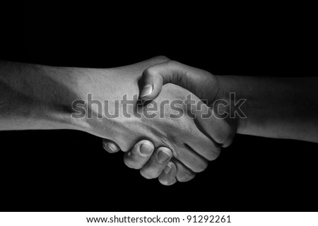 Two hands unite with eachother as deal agreement - stock photo