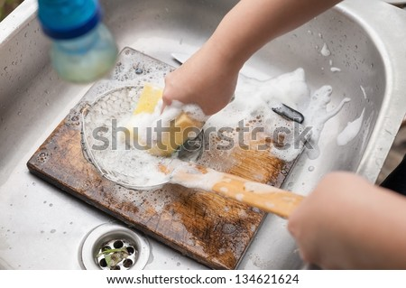 two hands washing colander - stock photo
