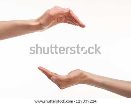 Two hands with copyspace between them - you can add your image, white background - stock photo