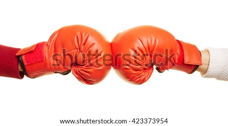 Two hands with red boxing gloves fighting against each other