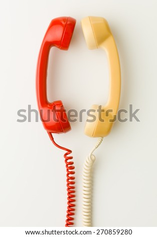 two handsets facing each other and talking - stock photo