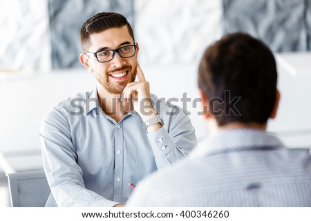 Two handsome businessmen in office - stock photo