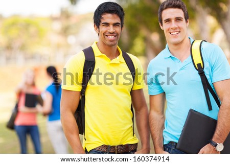 two handsome male college students outdoors on campus - stock photo