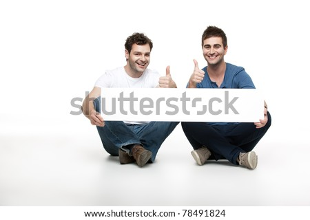 two handsome men approving an ad - stock photo