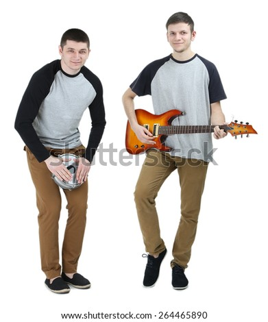 Two handsome young men with musical instruments isolated on white - stock photo