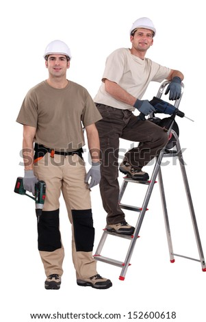 Two handyman with their driller. - stock photo