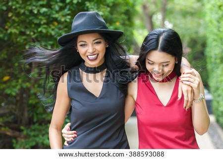 Two happy and lively female best friends having a good time together - friendship and fun time concept