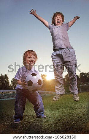 two happy boy play in soccer - stock photo