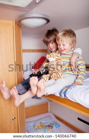 Two happy Boys In A Caravan - stock photo