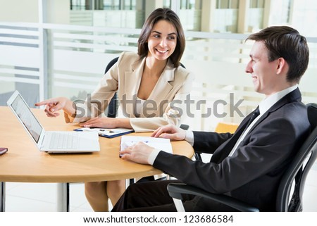 Two happy business people in a meeting at office - stock photo