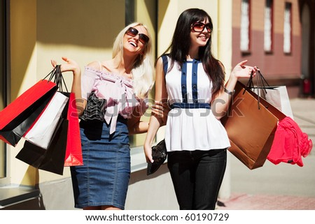 Two happy buyers. - stock photo