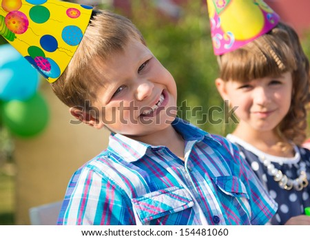 Two happy children having fun at birthday party - stock photo