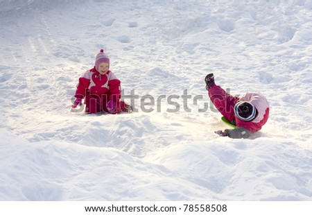 Two happy children playing in the snow - stock photo