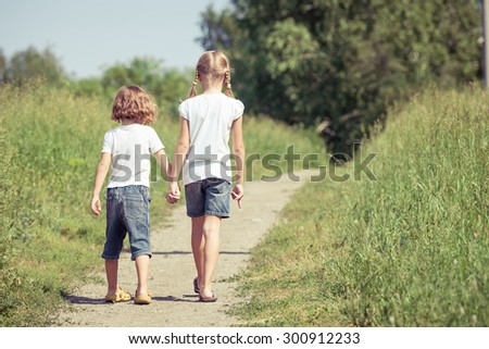 Two happy children  playing on the road at the day time