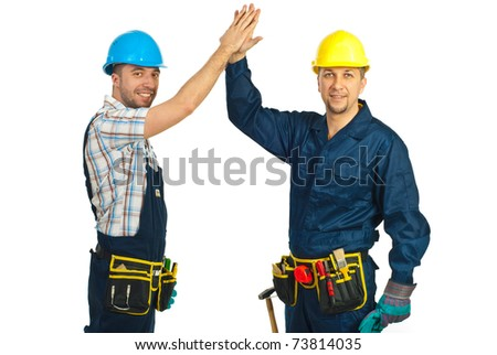 Two happy constructors workers giving high five isolated on white background - stock photo
