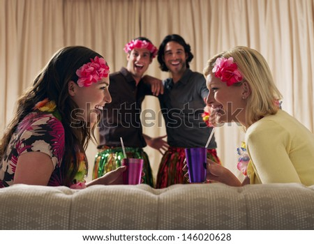 Two happy couples at dressing up party - stock photo