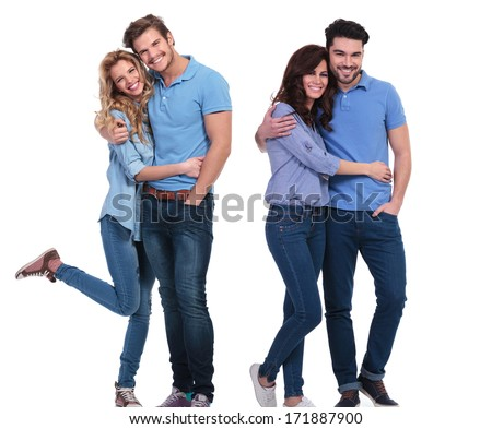 two happy couples of young casual people standing embraced on white background - stock photo