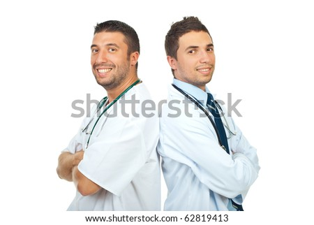 Two happy doctors men standing back to back with arms folded isolated on white background - stock photo