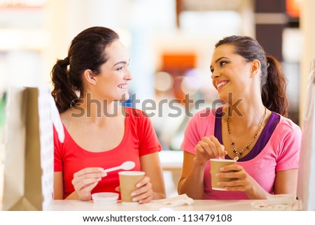 two happy friends having drinks in cafe - stock photo