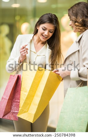 Two happy friends with shopping bag is shopping in mall. - stock photo