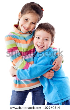 Two happy funny kids standing together and embracing, isolated on white - stock photo