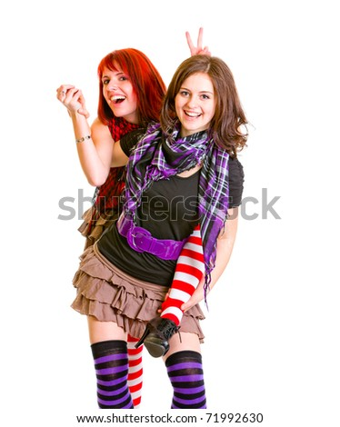 Two happy girlfriends  funny posing together isolated on white - stock photo