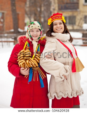 Two happy girls celebrating  Maslenitsa festival at Russia