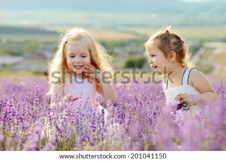 two happy girls in field - stock photo