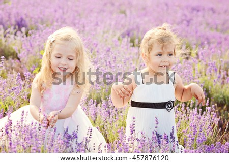 two happy girls in field of lavender