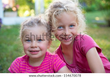 Two happy girls in the nature - stock photo